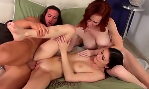Long haired dude pounds two nymphomaniac chicks in bed