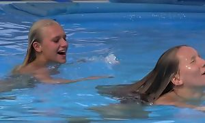 Two beautiful girls swimming and licking by the conjoin