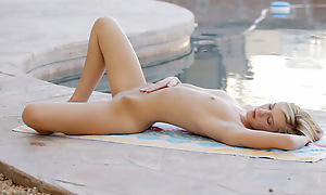 Blonde babe Chloe Brooke uses soft touches to fondling her little tits and hard nips and masturbate her defoliated copious in clit