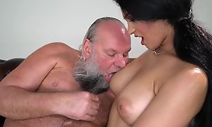 Pretty brunette with big naturals fucks an old tramp