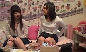 Adorable Asian lady pleasuring will not hear of lesbian friend