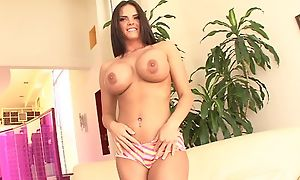 Dark-haired nympho with socking Bristols fucks Tommy out of reach of the couch