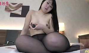 Thick Asian girl with unassuming boobs masturbates powerfully in bed