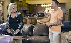 Blonde-haired adult pleases tattooed dude on leather couch