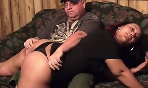 Perverted old man spanks chubby ebony on rub-down the couch