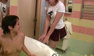 Sexy lesbian dominates hottie in bathtub dildo shagging