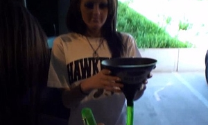 partying and flashing jugs while tailgating outside iowa city football game